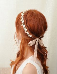 Such a pretty image and beautiful red hair.  https://www.flickr.com/photos/bellafaye8/