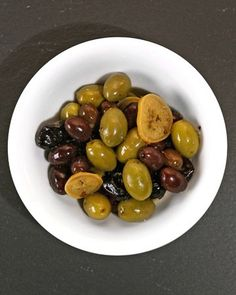 Preserved lemons add their distinctive rich, pungent flavor to assorted olives marinated in white-wine vinegar and olive oil.  You can make your own preserved lemons or purchase them at a Mediterranean specialty market.