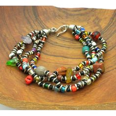 Showcase your love for color with this vibrant four-strand bracelet. Handcrafted by artisans in Kenya, this bracelet is designed using colorful glass, ceramic, and stone beads. The hook clasp closure
