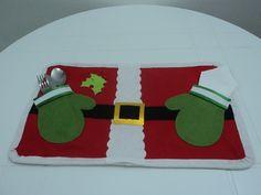 Jogo americano totalmente em feltro com porta talher, com tema natalino. Ideal para colocar na mesa na ceia de natal ou no almoço de natal, ou para festas temática cujo tema é o Natal. R$ 18,90