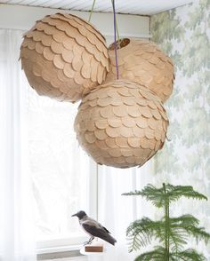 DIY: artichoke pendant shade made from old books