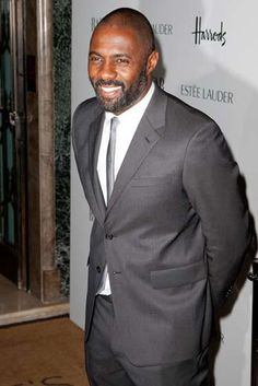 Idris Elba- I love the grey color of his suit and the sprinkles of grey hairs in his beard. I so heart him. #grownmanbi