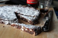 Panforte is best served cut into thin wedges. You can use any kinds of nuts you like – I prefer a mix of hazelnuts and almonds. To skin hazelnuts, rub the still-warm toasted nuts in a tea towel, to get off as much of the skins as possible. You can use another candied fruit, whatever is available.