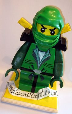 LLOYD GARMADON green Ninjago - Created for Icing Smiles and boy Luc who was celebrating his end of treatment. Luc has been battling Acute Lymphoblastic Leukemia since he was 20 months old. You can read more about the child's story here: http://swimtheriptide.wordpress.com/ Luc's celebration theme was Ninjago and his favorite ninja was the Green one LLOYD GARMADON. Luc's cake was almost 1.5 feet tall, chocolate and plastic-free :)