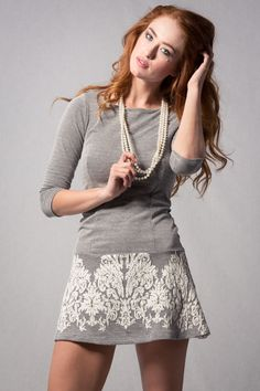 A lace embroidered skater dress with 3/4 sleeves. Looks cute with tall socks or tights and a knit hat.
