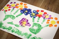 Preschool handprint flower craft - great for a letter of the week theme or to give to mothers/grandmothers for special occasions.