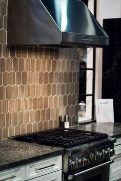 Walker Zanger's Jet Set Lantern Pattern in Mocha, with Thermador's Five Burner Pro Harmony Range / cooking appliance, from KBIS 2105
