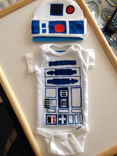 "Star Wars R2-D2 Onesie: Pre-Wash Onesie. Next, use a pencil & ruler to replicate the shapes. Then, color-in with Crayola Fabric markers. Fill in colors completely. Once dry, turn onesie inside-out and iron on Cotton setting until the color slightly changes (the color will change once it is ""set."") Once you set the colors, the onesie is ready to wear & wash as normal. May the force be with you! (Courtesy StephDodson.com)"