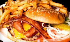 Groupon - Diner Food and Drinks at The 5 Point Café (52% Off). Two Options Available. in Seattle (Belltown). Groupon deal price: $12.00