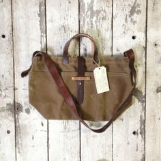 Hey, I found this really awesome Etsy listing at http://www.etsy.com/listing/156539620/waxed-canvas-tote-tumbleweed-antique