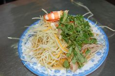 Vietnamese street food papaya salad with shrimps