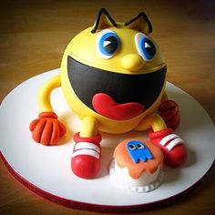 This Pac-man cake is awesome! Such amazingly clean and simple fondant design work. I almost can't believe it's cake.