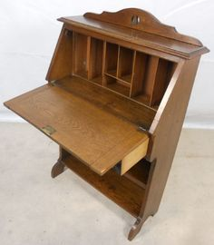 Desk.  What could I use this for in crafty space?  Would the Antiques Police get me for painting it?