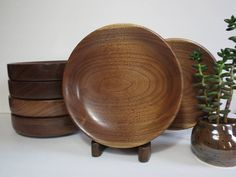 These Unique Mid Century Modern MCM Wood Walnut Salad Bowls have been Hand Turned. They are heavy, with thick sides and shallow basins and stack nicely. The lines of these are clean and sleek and ooze MCM style. The wood grain is gorgeous. Add wood and warmth to your table setting with these bold, stunning bowls. Condition: These bowls are in fabulous condition and dont seem to have been used. No cracks or chips. They do not scratches from utensils. There are very few minor scuffs to the…