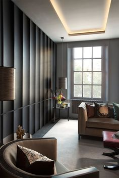 curved contemporary paneling; shallow [perimeter-lit coffer; offset pendant; anthracite & taupe; elegant lounge smallbone of devizes]