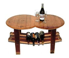 Picture yourself enjoying a glass of wine on this barrel coffee table. This unique wine rack table is made in the USA from used Vintage French Oak wine barrels.    The barrel table top is two full barrel heads with original French stamps. The wine barrel table base is made from naturally red wine stained wine barrel staves.