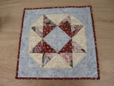 """Quilted Table Topper """"Copper Dandelions and Blue Roses"""" Patchwork Table Mat, Quilted Star, Reversible Table Topper, Quiltsy Team by ISewTotes on Etsy"""