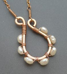 Copper Swirl Necklace with Freshwater Pearls. Starting at $8