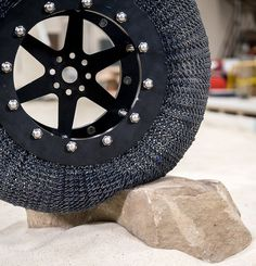 NASA's Shape Memory Alloy Tire rolling over a rock