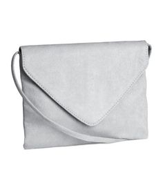 Shoulder bag in imitation suede with flap and magnetic fastener and a shoulder strap. 7 x 9 in. Grey Purses, Purses And Bags, H&m Handbags, Grey Handbags, Shoulder Strap Bag, Shopper, Shoulder Handbags, Cross Body Handbags, Sacks