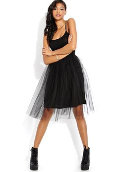 777099af42a18 This knee-length dress features a tulle skirt and a round neckline. Pair  this