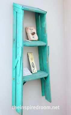 Painted step ladder hanging on the wall