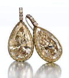 Hemmerle. A Pair of Champagne Diamond Earrings, Accented by Fancy Green Diamonds and Fancy Light Brown Diamonds. Mounted in White Gold and Brass. By Hemmerle.  Available Exclusively at FD.  www.fd-inspired.com