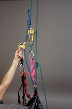 """Use the """"slingshot"""" technique to quickly and easily climb doubled rappel ropes that are rigged through metal hardware at the anchors. Pulling down on the jumar side of the rope as shown lifts up on the opposite side of the rope and voila, up you go. In most cases, at some point, you'll have to pass the knot joining the two ropes."""