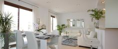 Ample and luminous white living room with access to terrace in townhouse for sale in Andratx, Mallorca