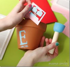 Beautiful and simple spring craft for kids: decorate terra cotta pots! From mamasmiles.com