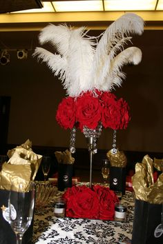 red rose centerpieces with white feathers, Hollywood theme wedding reception decor idea / Great Gatsby Party, Gatsby Theme, Feather Centerpieces, Party Centerpieces, Wedding Decorations, Vintage Hollywood Wedding, Hollywood Theme, Vintage Glam, Hollywood Glamour