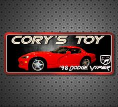 *****LOW FLAT RATE SHIPPING OF $9.95 ON CUSTOM SIGNS*****  Kick your garage or man cave décor into gear with a 1998 Dodge Viper personalized sign! The sleek curves and bright red shine of the body are enough to make you want to grab your keys and hit the road. Your custom name appears above with the year, make, model and viper logo below. This original garage art makes a great gift for car lovers!  If you're looking for a car sign with a specific make, model, and/or color, please visit o...