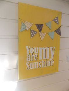 I like the cute bunting, would make the yellow more muted though