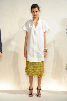 oversized white shirt dress and see through marni slip.