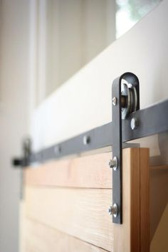 Barn Door Hardware. Umm, yes, now I'm sure these cost a pretty penny. Bet my husband could make these.