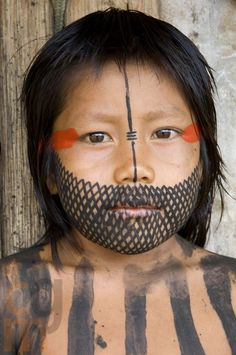 portrait face of a Kayapo boy by Cristina Mittermeier
