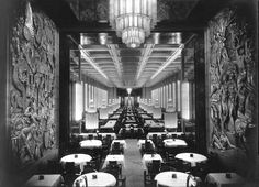 "First-Class Dining Hall on the SS Normandie, 1930's / The room could seat 700 at 157 tables, with Normandie serving as a floating promotion for the most sophisticated French cuisine of the period. As no natural light could enter it was illuminated by 12 tall pillars of Lalique glass flanked by 38 matching columns along the walls. These, with chandeliers hung at each end of the room, earned the Normandie the nickname ""Ship of Light"" (similar to Paris as the '""City of Light"")."""