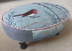 Robin on an oval stool.