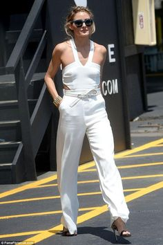 Olivia Palermo wearing Francesco Russo Leopard Print Calf Hair Sandals and Lovers + Friends Adore You Jumpsuit