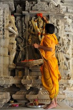 Offering of flowers at the Puja at Adinath Jain Temple, Ranakpur, Rajasthan, India -