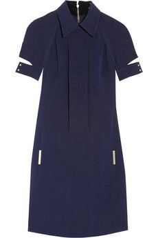 EXCLUSIVE TO NET-A-PORTER.COM. Victoria Beckham has made polished femininity her signature, so channel the label's impeccable style with this navy wool and silk-blend dress. With split cuffs and metal trims, attention is paid to every detail of this contemporary design - keep your accessories simple to show it off to elegant effect.