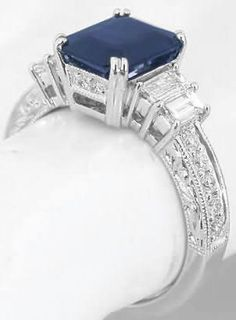 Engraved Emerald Cut Sapphire and Diamond Rings in 18k white gold