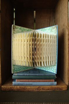 Folded used book  with interesting look - exploded library