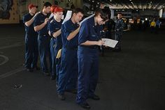 Sailors aboard the Nimitz-class aircraft carrier USS Dwight D. Eisenhower (CVN 69) fill out paper work for a medical history screening. Dwight D. Eisenhower is underway conducting training in the Atlantic Ocean.