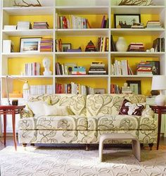 Domino magazine - I'm in love with the yellow walls and the white built in shelves.