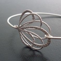 Check out her stuff. It's great. They would make great gifts as well. Bangle Bracelet Camilla  Silver by FrostedWillow on Etsy, $14.95