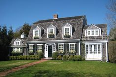 Browse the exterior images of Fuller Street Cape, a 1920's cape house located in historic Edgartown, Martha's Vineyard with significant additions including a carriage house, pool, and additional detailing on the exterior and interior