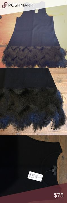 Black Fringe Sweater Black fringe sleeveless sweater. Nice warm material, fun and flirty! The Limited Sweaters Crew & Scoop Necks