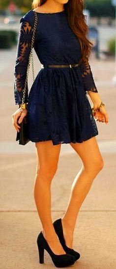 Black Handbag, Black High-Heeled Shoes And Black Belt, Short, Beautiful, Dark-Blue Dress, Golden Colored Bracelet.