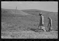 William Huravitch and son, carrying water to their home; the source is about a half mile away. Williams County, North Dakota. By Photographer Russell Lee, 1903-1986
